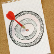 Stock Photo: Arrow hitting dartboard