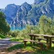 Picnic table by the lake - Stock Photo