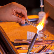 Glassblower working - Stock Photo