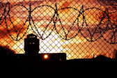 Sunset over prison yard — Stock Photo