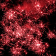 Red fireworks exploding — Stock Photo