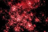 Red fireworks exploding — Stock Photo