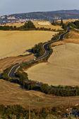 Toskánské klikatých silnic — Stock fotografie