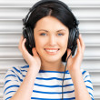 Happy teenage girl in big headphones — Stock Photo #10303804