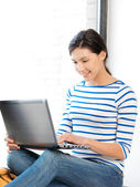 Happy teenage girl with laptop computer — Stock Photo
