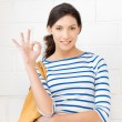 Lovely teenage girl showing ok sign — Stock Photo #10375833
