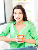 Lovely woman with mug — Stock Photo