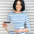 Happy woman with tablet pc computer - Stock Photo