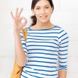 Lovely teenage girl showing ok sign — Stock Photo #10392367
