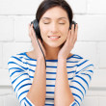 Happy teenage girl in big headphones — Stock Photo #10392385