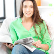 Happy and smiling woman with magazine — Stock Photo #10392408