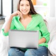 Happy woman with laptop computer — Stock Photo #10392432