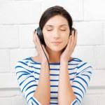 Happy teenage girl in big headphones — Stock Photo #10423518