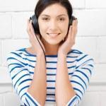 Happy teenage girl in big headphones — Stock Photo #10456952