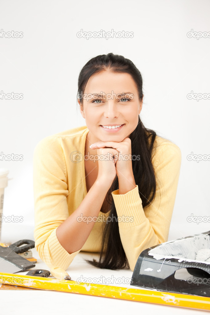 Bright picture of lovely housewife making repairing works  Stock Photo #10475792