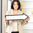 Businesswoman with direction arrow sign — Stock Photo #10523161