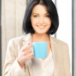 Lovely businesswoman with mug — Stock Photo #10523185