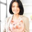 Lovely woman with piggy bank — Stock Photo #10523190