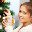Woman decorating christmas tree — Stok fotoğraf