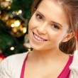 Stock Photo: Woman decorating christmas tree