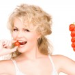 Young beautiful woman with ripe tomatoes — Stock Photo