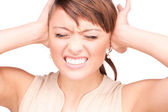 Unhappy woman with hands on ears — Stock Photo