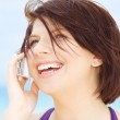 Happy woman with white phone — Stock Photo