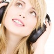 Teenage girl in headphones over white — Stock Photo #7971005