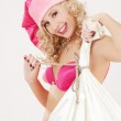 Cheerful santa helper girl with big bag — Stock Photo #7973931