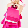 Cheerful santa helper girl with shopping bags — Stock Photo #7973979