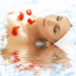 Red petals spa with water — Stock Photo