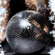 Foto Stock: Fishnet stockings and disco ball
