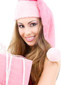 Happy santa helper with gift box — Stock Photo