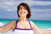 Happy woman with white sarong — Stock Photo