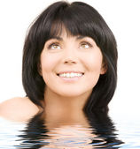 Happy woman looking up — Stock Photo