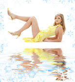 Laying girl in yellow dress on white sand — Stock Photo