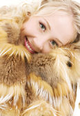 Lovely blonde in fur over white — Stock Photo
