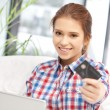 Happy woman with laptop computer and credit card - ストック写真
