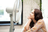 Happy woman with big fan — Stock Photo