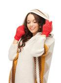 Beautiful woman in white sweater — Stock Photo