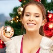 Woman decorating christmas tree — Stock Photo