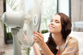 Happy woman with big fan — Stockfoto