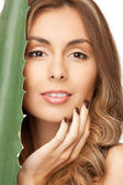 Lovely woman with aloe vera — Stock Photo