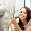 Stock Photo: Happy womwith big fan