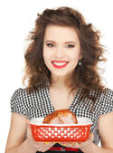 Lovely housewife with meat — Stock Photo