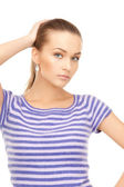 Lovely woman in striped sweater — Stock Photo