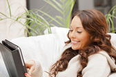Happy woman with tablet pc computer — Stockfoto