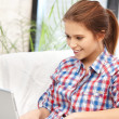 Happy woman with laptop computer - Stock Photo