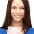 Lovely woman with piggy bank - ストック写真