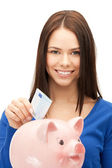 Lovely woman with piggy bank and money — Stock Photo